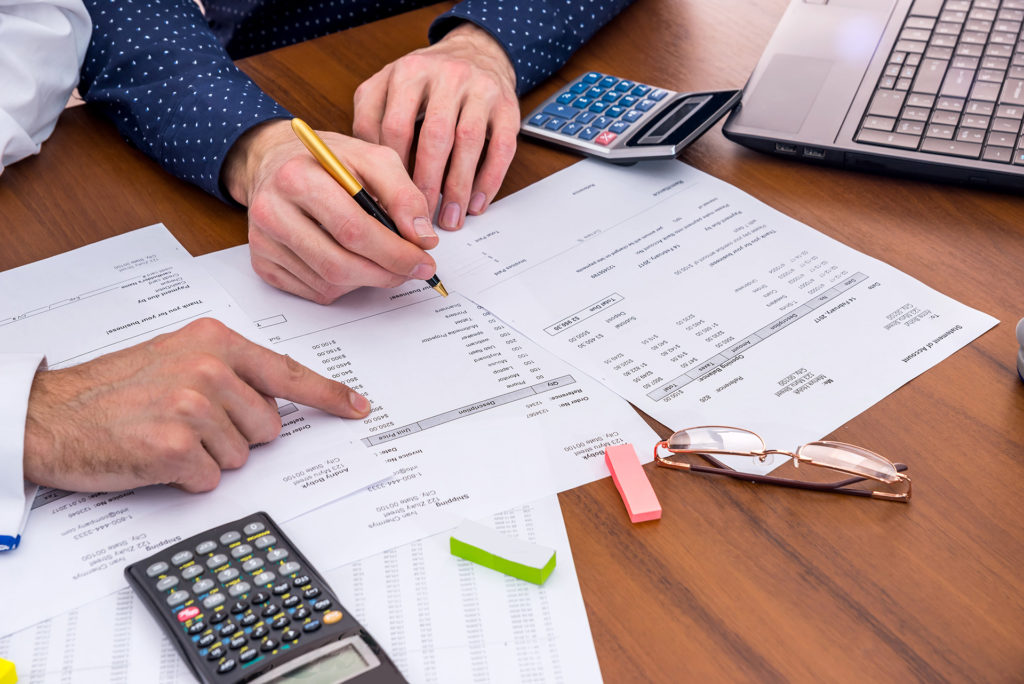 small business accountant Fitzgibbon documents and calculator on table