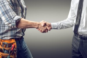 A Contractor And An Employer Shake Hands