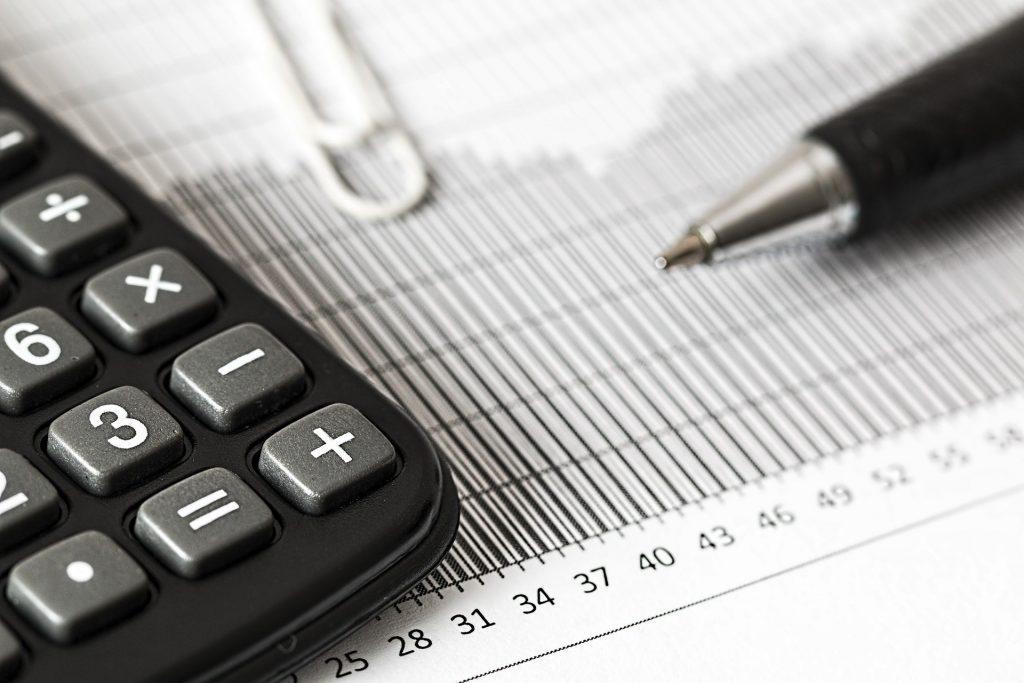 accountancy firm calculator and pen