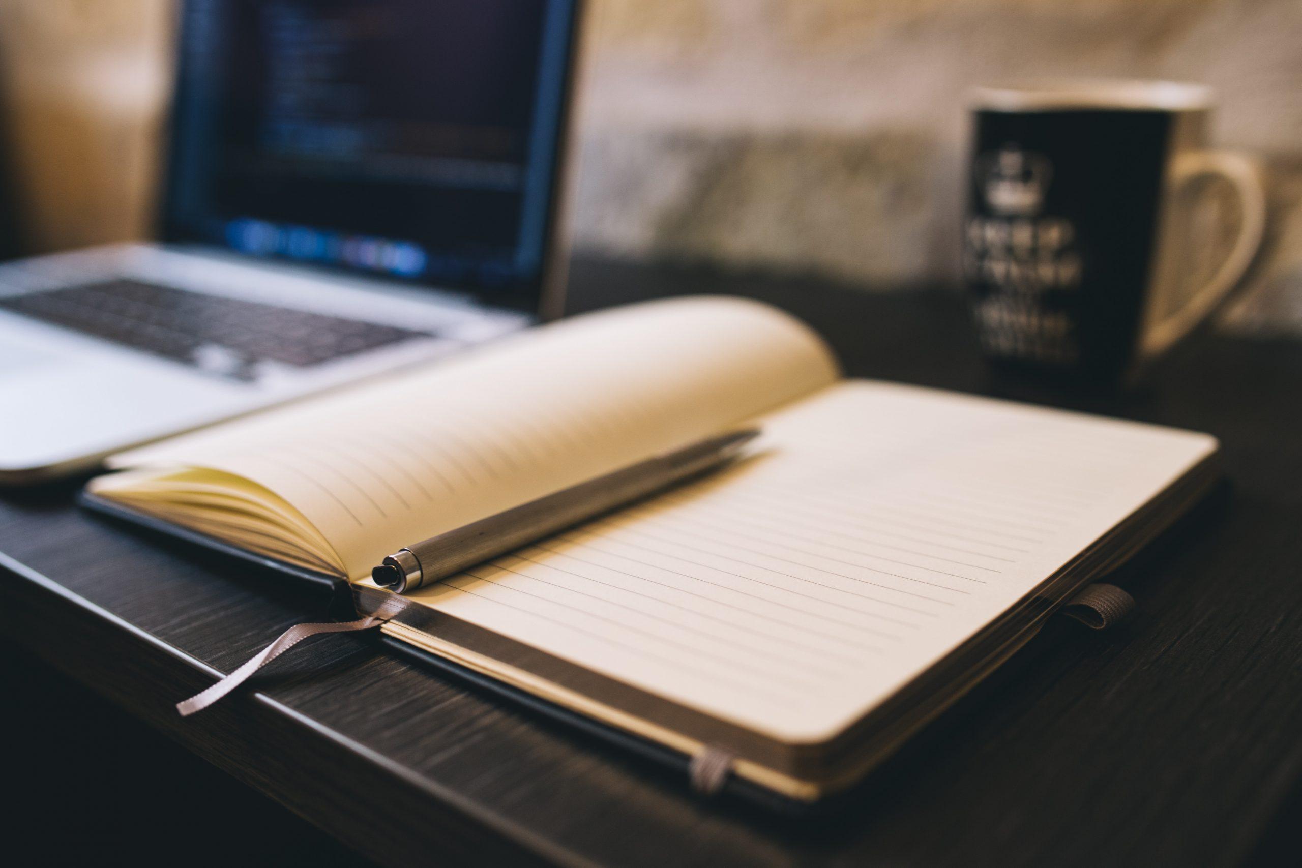 managements accountants brisbane notebook on desk