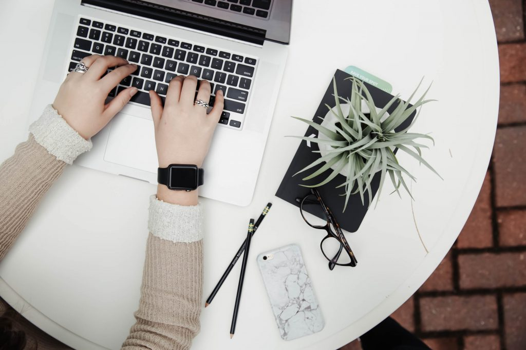 accountancy firm woman using laptop