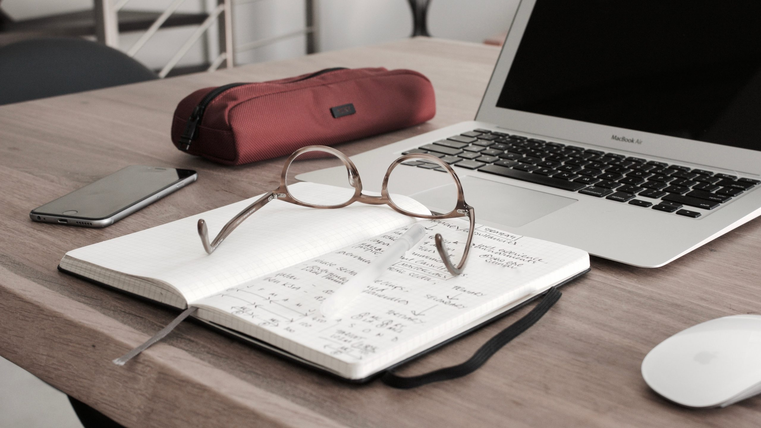 tax preparation services - notebook and glasses on desk