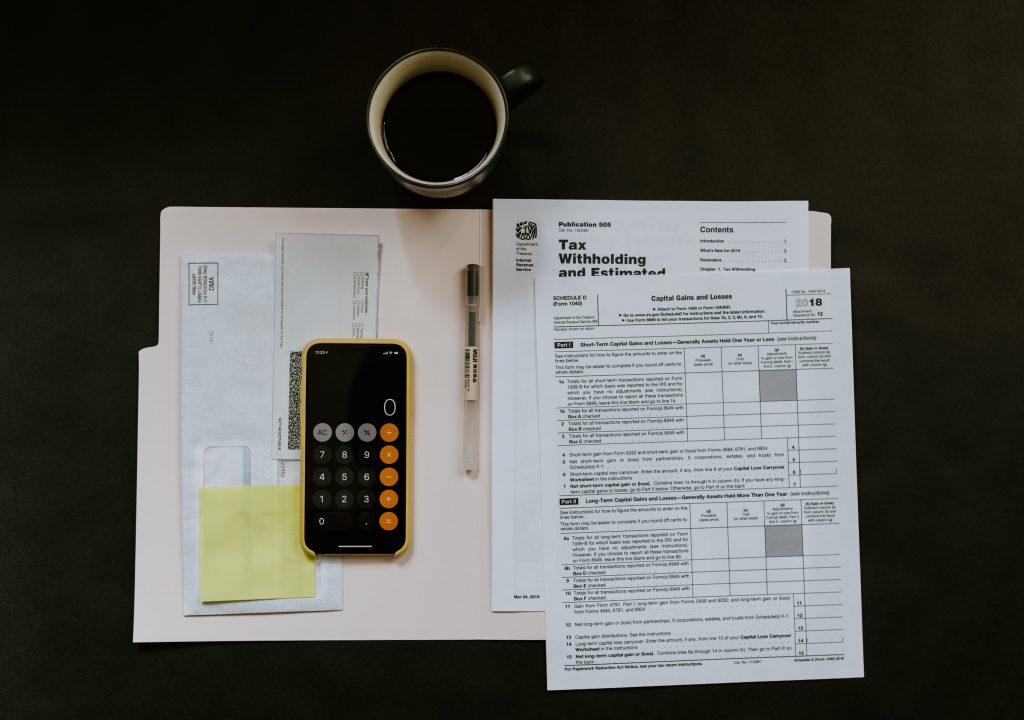 business accountant Geebung phone and docket on table