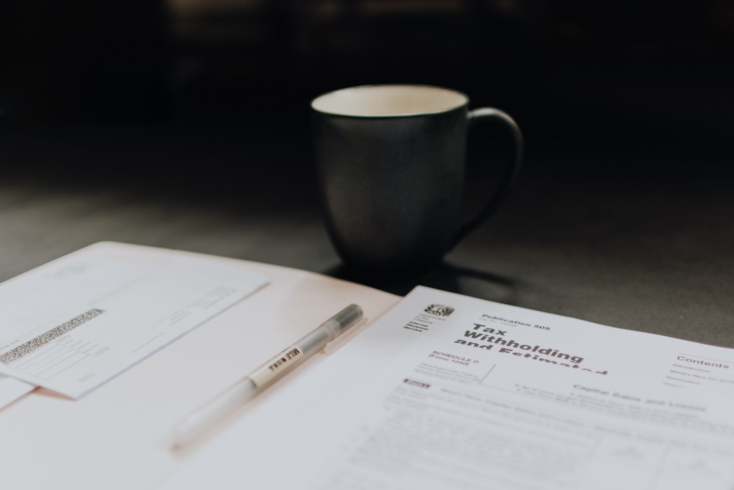 bookkeeping services aspley documents and mug on surface