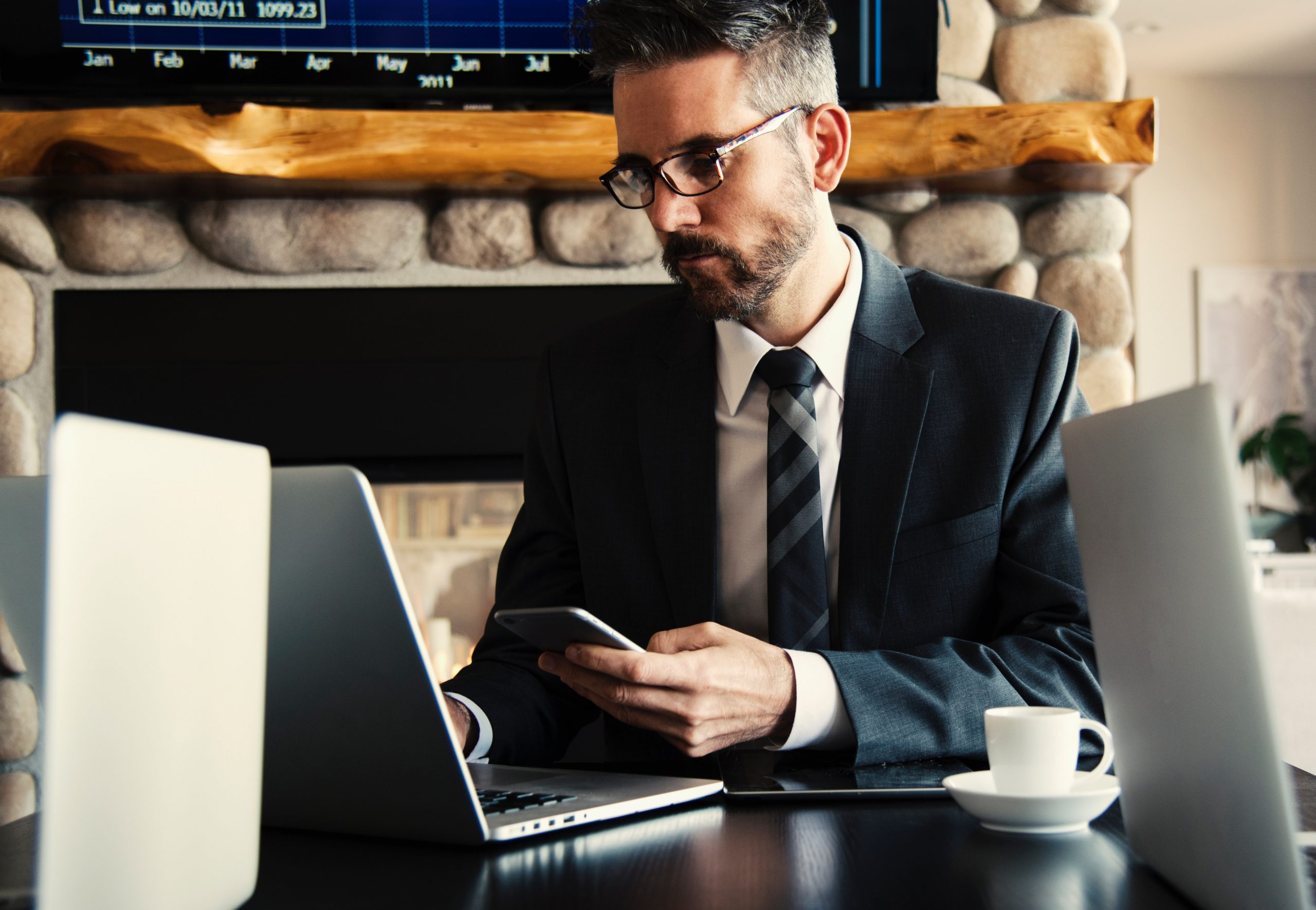business accountant brisbane - man using laptop and phone