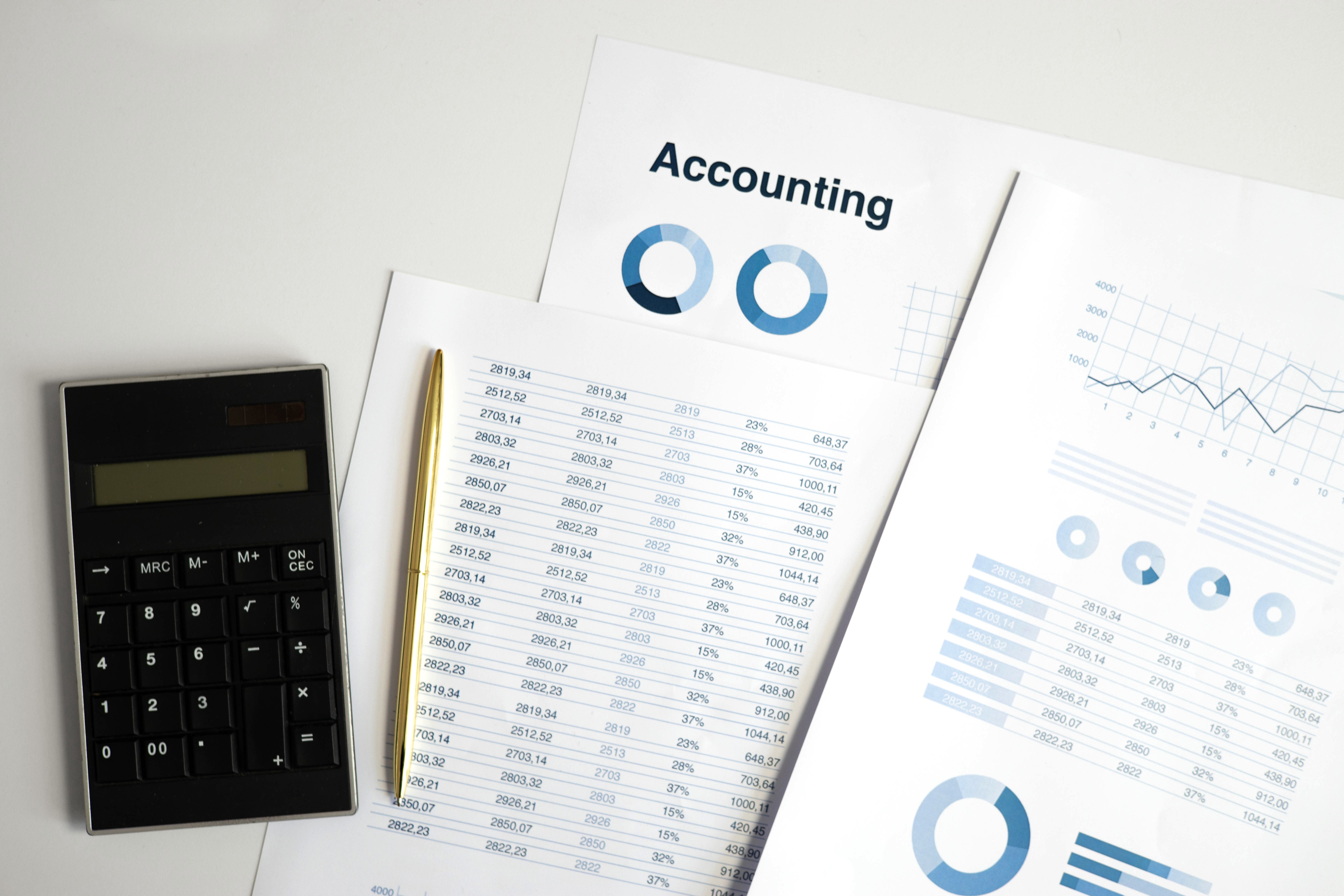 Online Bookkeeping - calculator and documents on surface