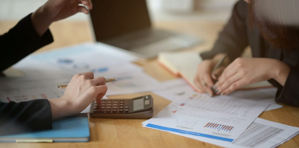 bookkeeping services Chermside women at table using calculator