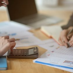bookkeeping services brisbane - people using a calculator