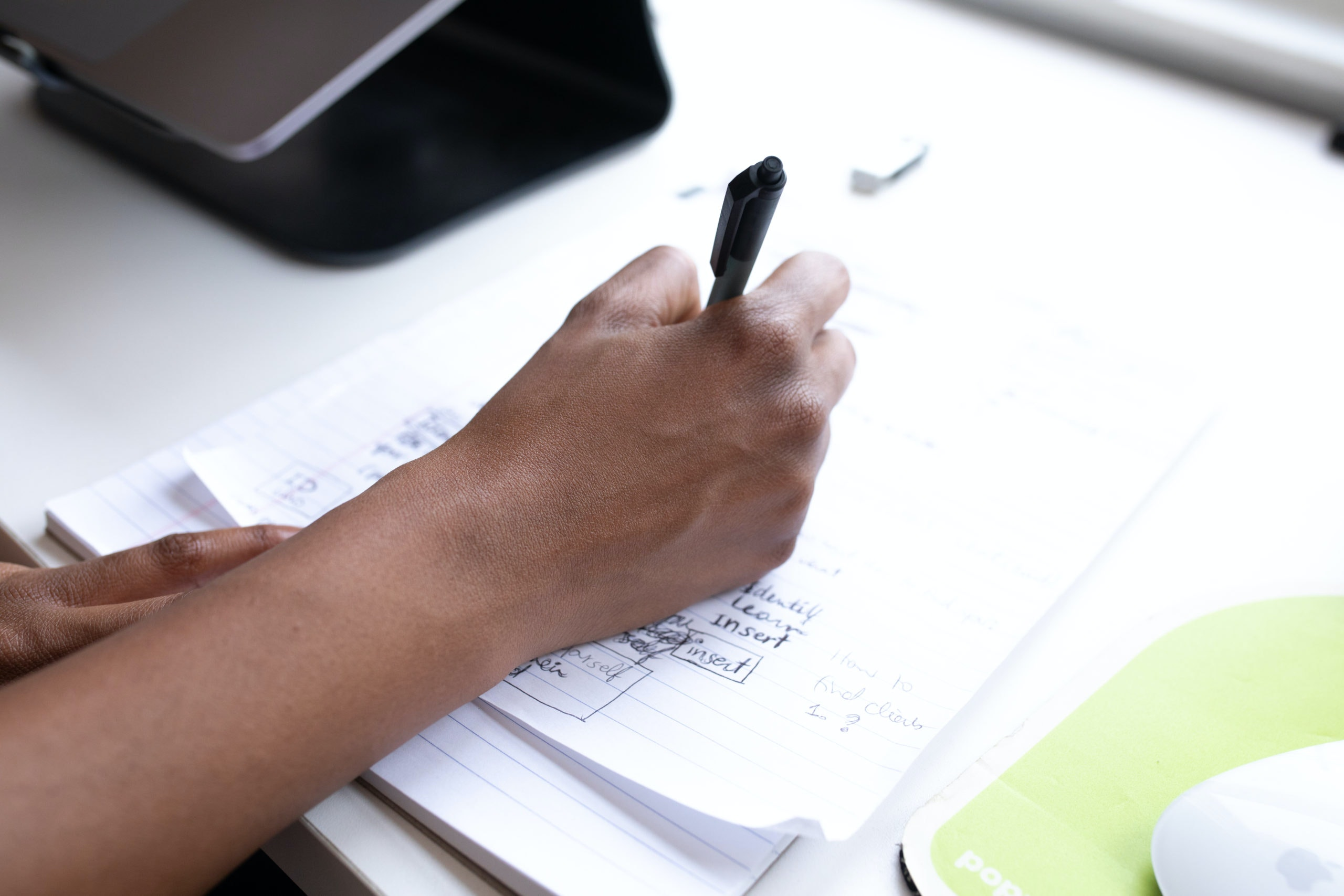 tax services - person writing with pen
