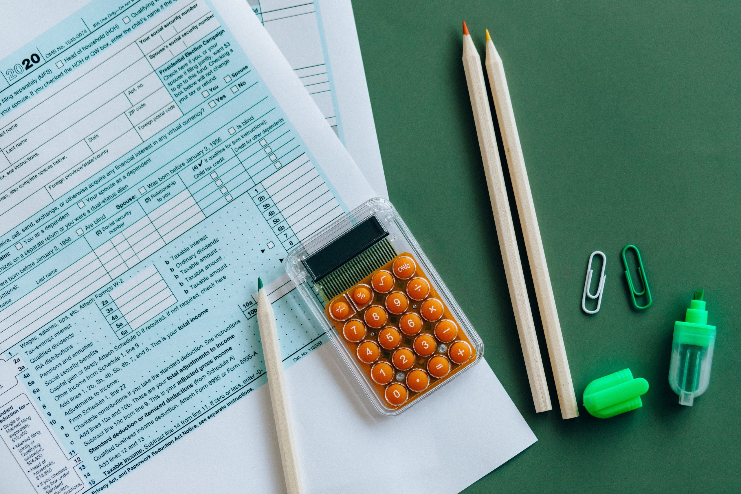 Accountant Brisbane - paper, calculator and stationery on surface