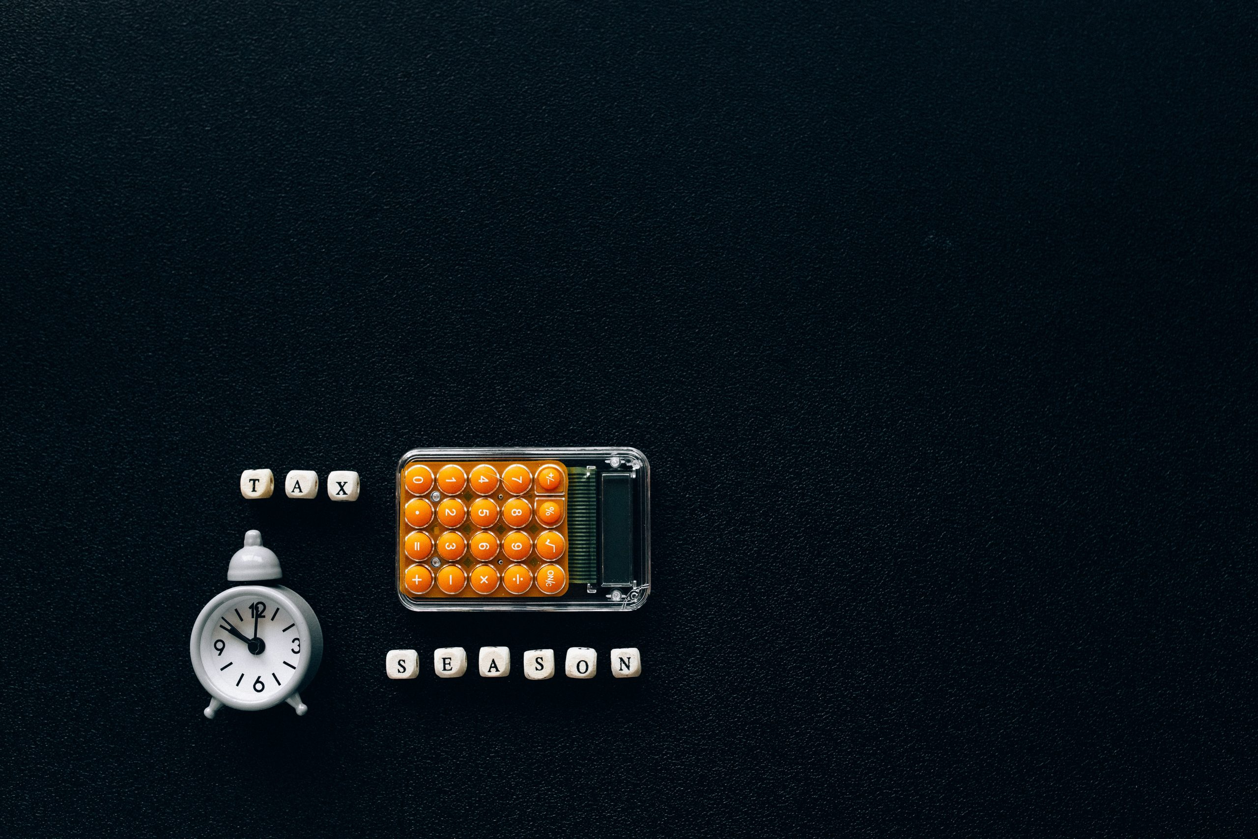 Tax Agent Brisbane - calculator on black surface