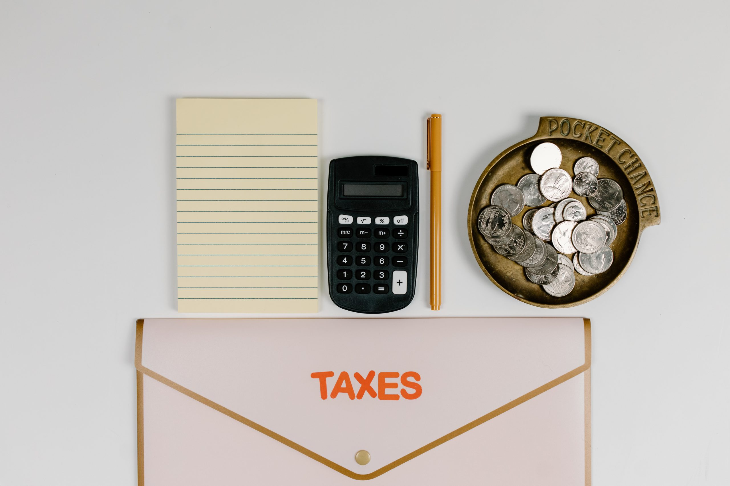 Tax Accountants Brisbane - calculator and stationery on surface