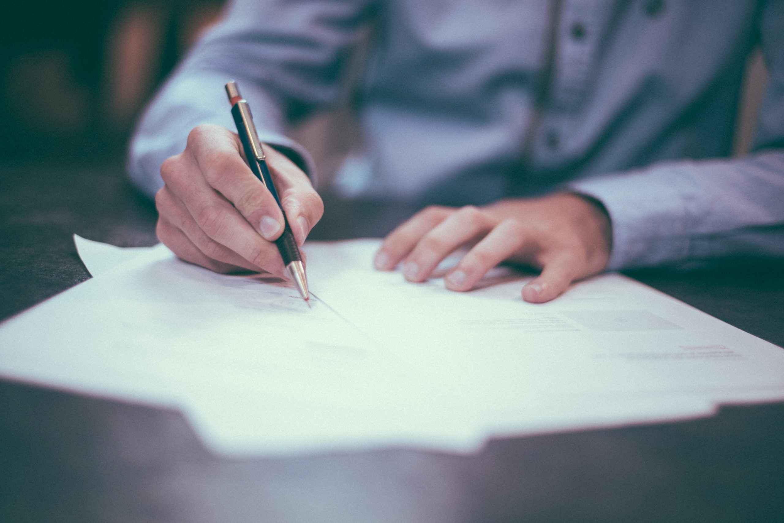lodging a tax return man writing on paper